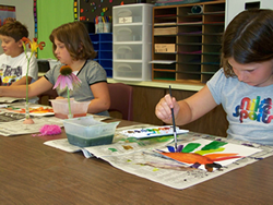 Picture of students doing artwork in a classroom